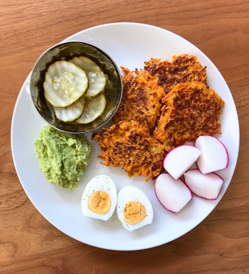 Scraps lunch with sweet potato fritters and vegetables (pickles, avocado, hard boiled egg, radish)