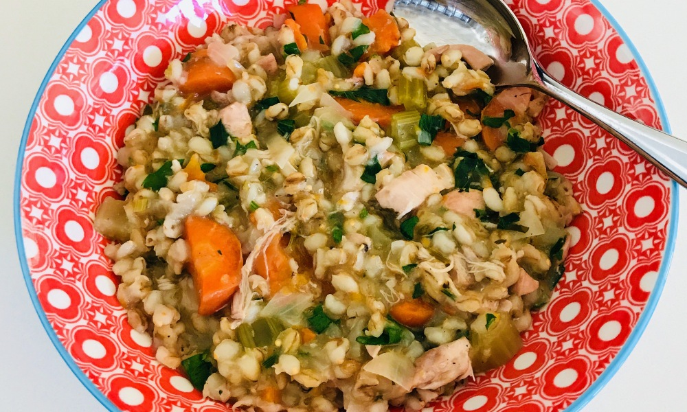 Wilkie's Chicken Soup in red bowl with spoon