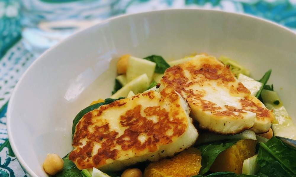 Bowl of fennel, chickpea and orange salad with haloumi